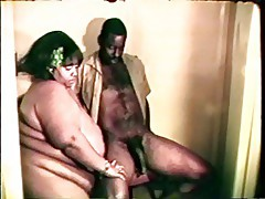Big fat gigantic black bitch loves a hard black cock between her lips and legs