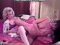 Kinky lesbian couple bedroom fun