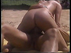 Peter North shags a hot blonde on the beach